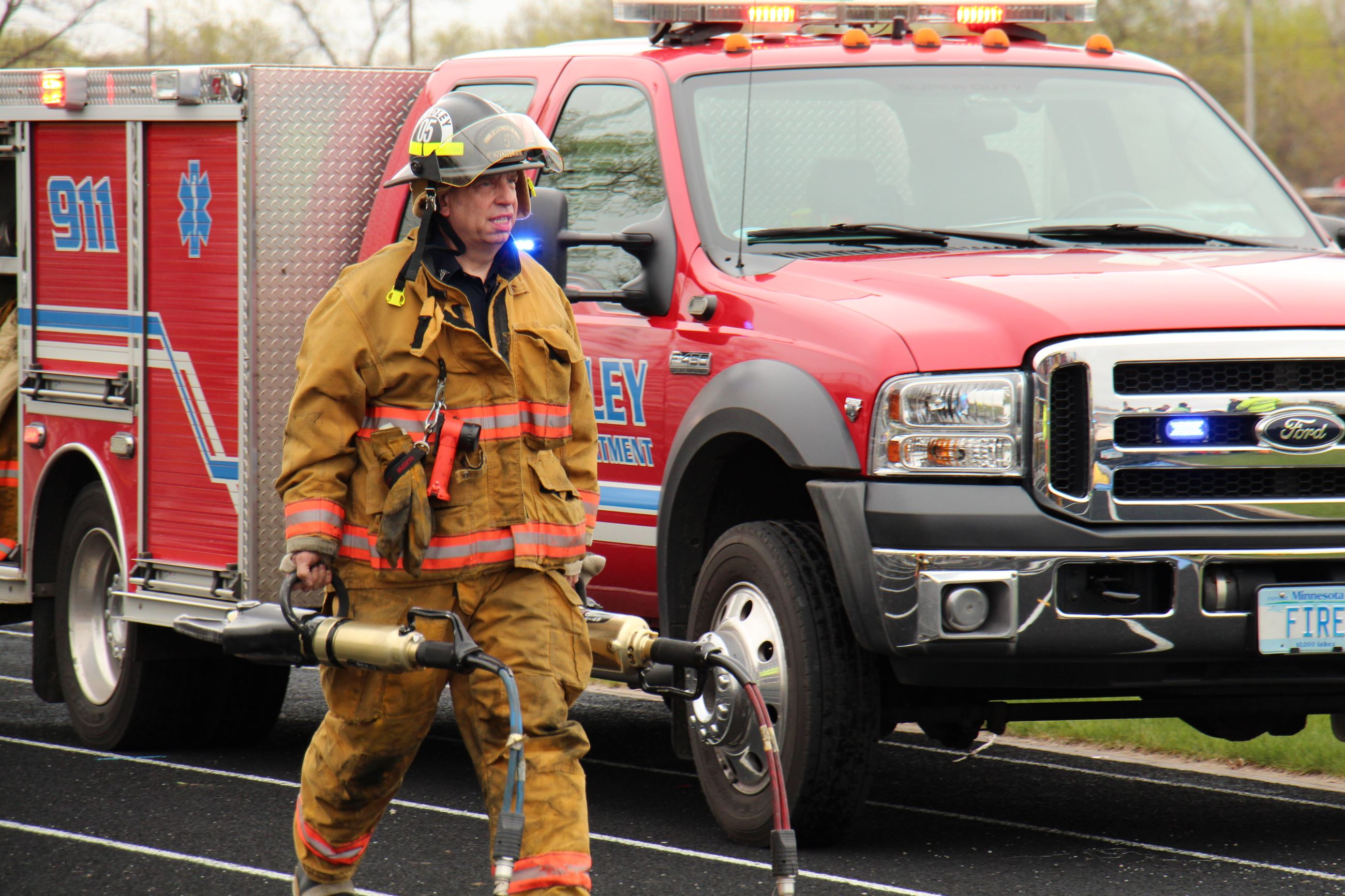 firefighter carrying jaws of life